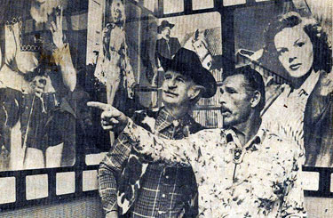 Buster Crabbe guides Slim Andrews to a photo of Buster as Flash Gordon during a visit to Harlow's Restaurant in Memphis, TN. The two cowboys were in Memphis for an early film festival. (Thanx to Billy Holcomb.)
