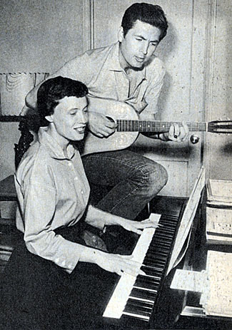 Davy Crockett...Fess Parker, a guitar player since college days, composes a tune in 1955 with his then girfriend Marcy Rinehart.