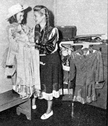 Mama Gail Davis readies her daughter Terrie for her first photo shoot in 1958.