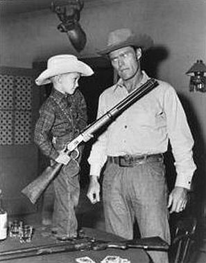 "Fraser Heston, Charlton Heston's son, gets the drop on ""The Rifleman"" with Chuck Connors' own Winchester."