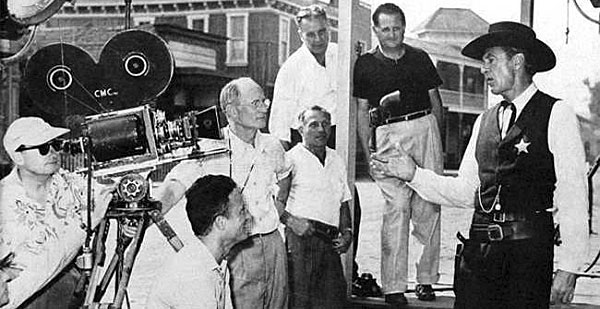 "Gary Cooper talks with crew members while making ""High Noon"" ('52 U.A.)."