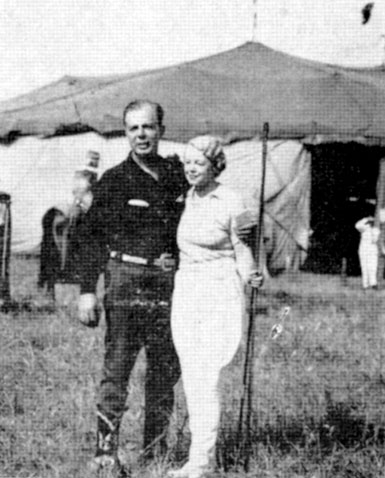 Hoot Gibson and Mrs. Poodles Hanneford on the Hagenbeck-Wallace Circus lot in Norfolk, VA on August 9, 1937.