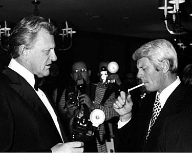 James Arness seems to look disapprovingly upon brother Peter Graves' smoking.