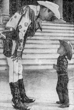 ...on the other hand, Roy Rogers has to bend down to say hello to a young admirer while Roy was appearing at the Madison Square Garden Rodeo in March 1959.