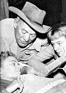 "Ward Bond of ""Wagon Train"" makes a visit to a children's hospital."
