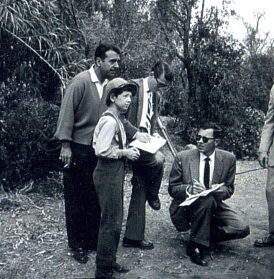 "Preparing to shoot a scene for ""Buckskin"" ('58) are young star Tommy Nolan and a couple of production people. Singer Tennessee Ernie Ford looks on. ""Buckskin"" was originally the summer replacement for Tennessee Ernie's popular TV series."