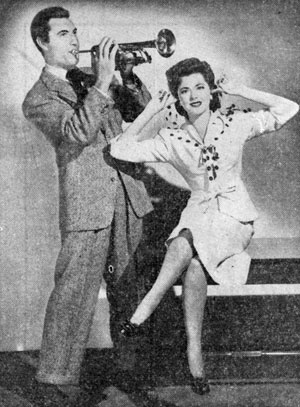 "Out of Western garb in 1942 to make ""Orchestra Wives"" are George Montgomery and Gene Autry leading lady Ann Rutherford."