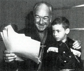 Hopalong Cassidy shows a young fan the script for his next radio broadcast.