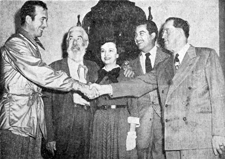 "John Payne, Gabby Hayes, Mrs. Bill Thomas (wife of producer Bill Thomas) and Eduardo Noriega receive a warm welcome to El Paso for the premiere of ""El Paso"" from John Paxton (right, manager of Inter-State Theatres)."