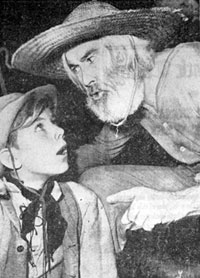 "Young actor Bobby Ellis gets a few tips from Gabby Hayes at the premiere of ""El Paso"" (3/25/49)."