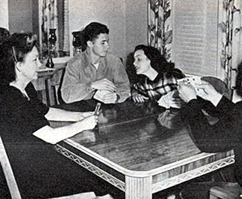 In 1948, Audie Murphy and his soon-to-be wife actress Wanda Hendrix play cards with Wanda's parents. The couple were married in 1949.