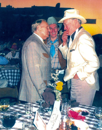 Gene Autry shares a little humor with a bemused Charles Starrett and Pat Buttram at a Hollywood function. (Thanx to John Buttram.)
