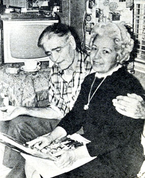 Silent and early '30s B-Western star Jack Hoxie and his wife Bonnie flip through a scrapbook of Jack's films in May 1964.
