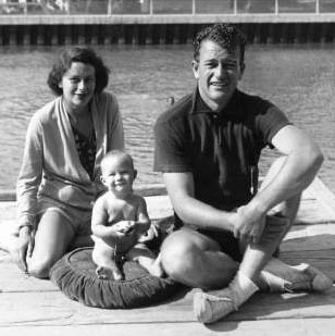 John Wayne with wife Josephine Saenz and son Michael. They were married from '33 to '45.