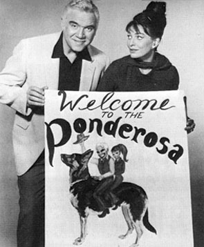 "Lorne Greene, Ben Cartwright on ""Bonanza"", displays a welcoming sign produced by is wife Nancy for the benefit of weekend guests at their Mesa, AZ, home. The couple were married in 1961."