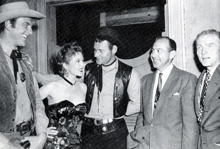 "On the set for ""Gunsmoke: Hack Prine"", the first episode filmed, are (L-R) James Arness, Amanda Blake, Leo Gordon, Harry Ackerman (VP in charge of CBS West Coast progamming) and Hal Hudson (CBS program advisor)."