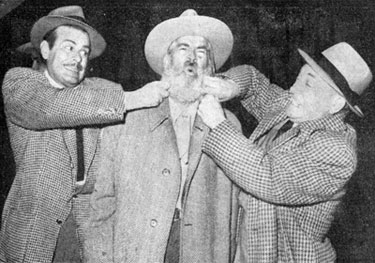 "Billy De Wolff and William Demarest jokingly try to see if Gabby Hayes' whiskers are real. Promotional photo for the Houston, TX premiere 2/4/48 of ""Albuquerque""."