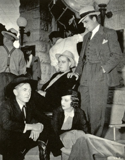 "Harry Carey, Margaret Callahan, Hoot Gibson and Tom Tyler take a break while filming RKO's ""The Last Outlaw"" ('36)."