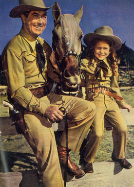 Monogram B-Western star Johnny Mack Brown with his cowgirl daughter Cynthia.