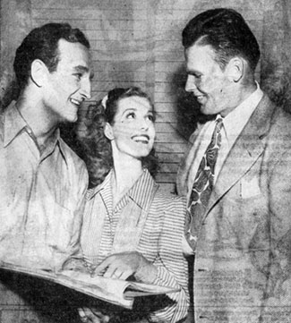 "Tom Harmon and John Kimbrough, team mates on the mythical All-America Football Team, meet on August 26, 1941 at Columbia Studios where Harmon was filming ""Harmon of Michigan"" ('41) co-starring Anita Louise (center). Kimbrough starred in ""Sundown Jim"" and ""Lone Star Ranger"" (both '42) at 20th Century Fox."