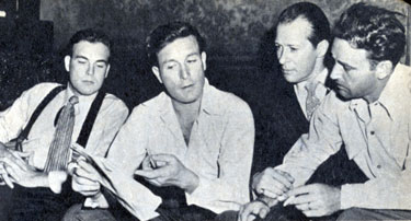 "Scott Brady, circa 1945, before he was in the movies, visited a set with his brother Lawrence Tierney (center), actor Morgan Conway and director Gordon Douglas. Brady eventually starred in several Westerns and was TV's ""Shotgun Slade""."