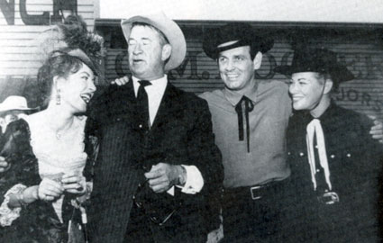 "Amanda Blake, Miss Kitty on ""Gunsmoke"", along with Chill Wills and Mr. and Mrs. David Janssen, in Dodge City, KS to dedicate Front Street in 1958."