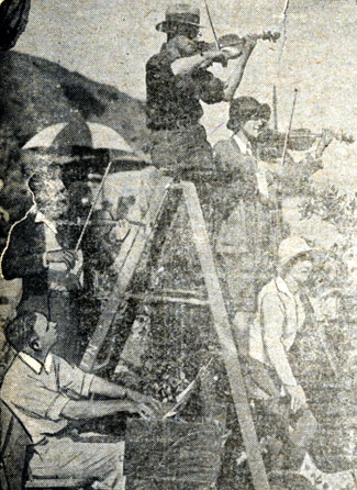 Live music was often played on the set of silent films to inspire the actors. This rare 1920s photo shows Rudolph Berliner, a former symphony orchestra conductor who was then a studio musical director, playing a violin on the top step of a ladder.