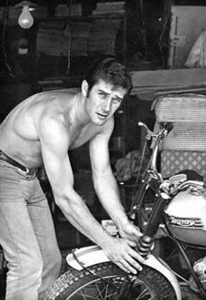 """Laramie"" star Robert Fuller prepares to take a ride on his motorbike. (Thanx to Terry Cutts)."
