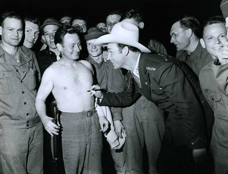 Wonder if this soldier still has the autograph on his chest? Roy Rogers visiting troops in the early '40s.