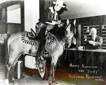 Before he became Sunset Carson, Mickey Harrison rode a horse named Dusty into the lobby of the Hollywood Roosevelt Hotel in L.A. for a publicity shot.