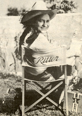 Monogram B-Western star Tex Ritter takes a break between scenes.