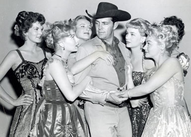 "Dale Robertson as Wells Fargo agent Jim Hardie tangles with a bevy of dancehall girls in the 1960 episode ""The Governor's Visit"". (L-R) Mari Blanchard, Joan Staley, Mari Lynn, Joan Granville, Helen Stern and (partly hidden) Kristina Hansen."
