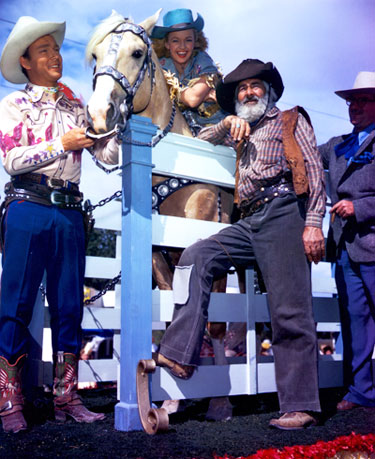 Roy Rogers, Dale Evans on Trigger and Gabby Hayes during a rodeo performance.