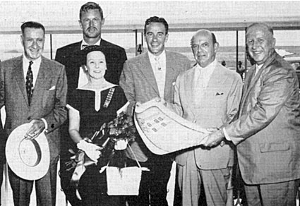 "At the premiere of ""The Last Command"" associate producer Frank Lloyd (left), stars Sterling Hayden, Richard Carlson and Republic prexy Herbert J. Yates are presented with an official Heritage of Freedom Day proclamation by San Antonio Mayor Kuykendall (right) and Mrs. Megarity, acting for Texas Citizens and Pioneer Patriots."