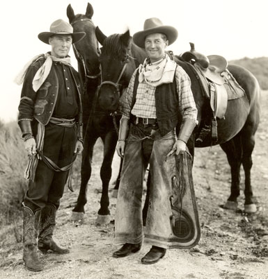 A duded up Maurice Chevalier visits silent Western star William S. Hart at Hart's ranch in Newhall, CA.