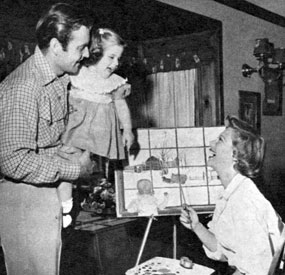 George Montgomery with five year old daughter Missy and wife Dinah Shore in 1952.