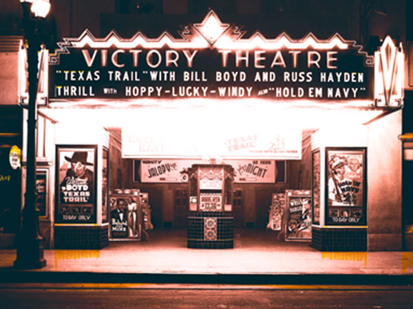 "Nostalgia! Here's the way we used to enjoy going to the movies. Two shots of the Victory Theatre (anybody know in what town this theatre might have been?) in 1941 showing a double feature of Hoppy's ""Texas Trail"" (in re-release) and ""Hold 'Em Navy"" with Abbott and Costello. Notice the poster to the right of the boxoffice shows ""Wells Fargo"" with Joel McCrea as coming soon."