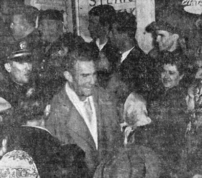 "State Police formed an escort line for Randolph Scott as he arrived at the Kimo Theatre for the world premiere of ""Albuquerque""."