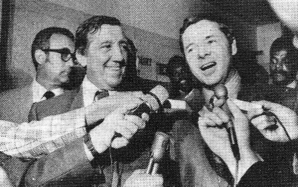 Audie Murphy faces newsmen in 1970. Man with Audie is Paul Caruso, his attorney when Audie was charged with the attempted murder of a kennel owner in a dispute over a dog. Audie was acquitted. (Thanks to Vic Mizzone.)