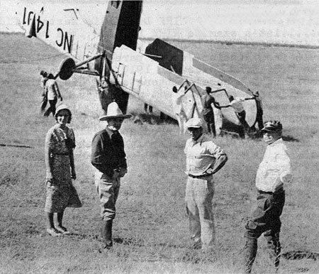 "(L-R) Doris Hill, Bob Steele, producer Paul Malvern and director Robert Bradbury. Taken at the time of the filming of either ""Galloping Romeo"" or ""Ranger's Code"" both made in 1933 with Steele and Doris Hill. Wreckage of the airplane is unknown but is not featured in either film."