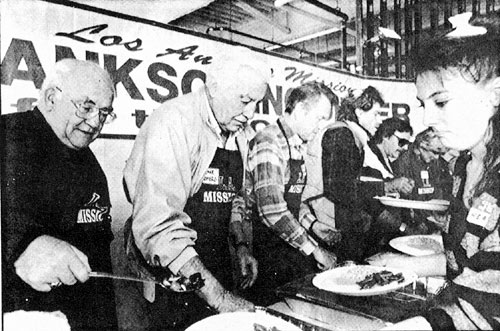 "Actors Ed Asner, Cesar Romero (Cisco Kid), Earl Holliman (TV's ""Hotel de Paree"") help dish up Thanksgiving dinners for the homeless at the L. A. Mission in November '90."