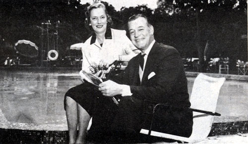 Charles Starrett and wife Mary relax beside their pool.