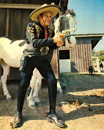 "An elder Duncan Renaldo relives some ""Cisco Kid"" memories, but check out the footgear!"