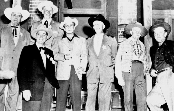 A classic cowboy reunion on the Paramount lot in the early '60s. (L-R) Ken Maynard, Tom Keene, Rex Lease, Bob Steele, Hoot Gibson, Raymond Hatton, Big Boy Williams.