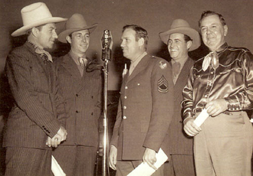 "Gene Autry's ""Melody Ranch"" CBS radio show emanated from Luke Air Force Base in Arizona from 1940-1945. (L-R) Dick Reinhart, Eddie Dean, Gene, Jimmie Davis (Eddie's brother) and show comic Horace Murphy, known as ""Shorty Long"" on the program. In the late '30s Murphy was a B-western screen sidekick to Tex Ritter (often named Stubby or Ananias). Murphy played dozens of sheriffs and other characters on screen from '35-'45. (Thanks for ID help to O. J. Sikes, Jimmy Glover, Billy Holcomb.)"