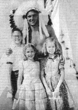 "Keith Larsen as TV's ""Brave Eagle"" poses circa 1955-'56 with Robert, Sherron and Beverly Forrester of Oklahoma."