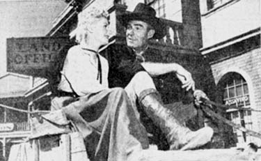 "Lucille Norman and Randolph Scott take a break from filming ""Carson City"" ('52 WB)."