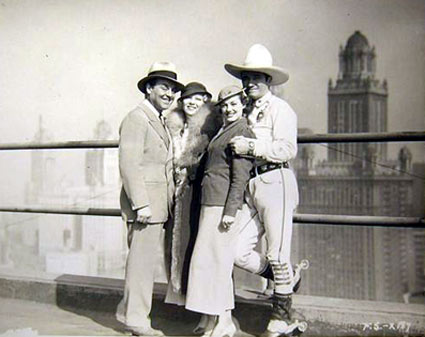 Leo Carrillo and Tom Mix pose with two lovely ladies in Chicago in 1933.