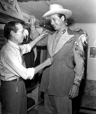 Monte Hale gets fitted for a new suit at Nudie's Western Tailor Shop.