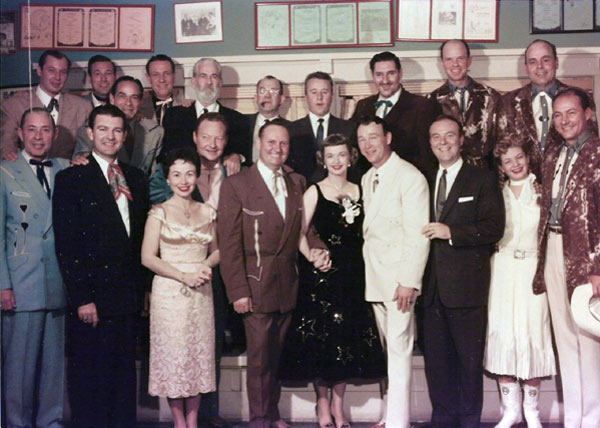"(L-R Top Row) Sons of the Pioneers: Dale Warren, Tommy Doss, Shug Fisher, Lloyd Perryman. Gabby Hayes, unknown, George Gobel, Pat Buttram, Cass County Boys: Fred Martin, Bert Dodson. (L-R Bottom Row) Sons of the Pioneers: Karl Farr. Tex Williams, Connie Haines, Pat Brady, Gene Autry, Dale Evans, Roy Rogers, Ralph Edwards, Gail Davis, Jerry Scoggins of the Cass County Boys. We're not sure but believe this photo was taken during Gene Autry's ""This is Your Life"" TV program with Edwards. (Photo courtesy Dale Price via Gail Davis.)"